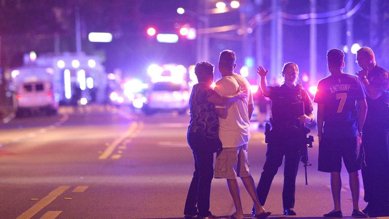 Orlando Police officers direct family members away from a fatal shooting at Pulse Orlando nightclub in Orlando