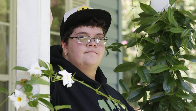 In this Aug. 25, 2015 file photo, Gavin Grimm poses on his front porch during an interview at his home in Gloucester, Va. (AP Photo/Steve Helber, File)