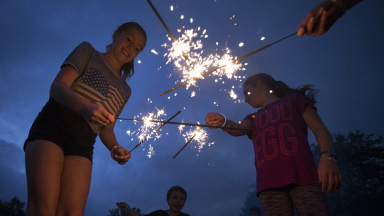 Children celebrate Fourth of July in Cincinnati last year. New Jersey lawmakers are considering allowing those 16 and older to buy and use sparklers. (AP file photo)
