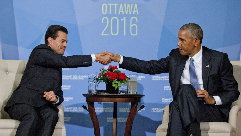 In this Wednesday, June 29, 2016 file photo, President Barack Obama shakes hands with Mexican President Enrique Pena Neito during their bilateral meeting at the National Gallery of Canada in Ottawa, Canada. (AP Photo/Pablo Martinez Monsivais, File)