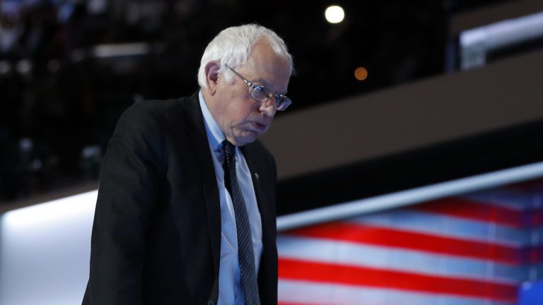 Former Democratic presidential candidate Sen. Bernie Sanders walks off the stage after speaking to delegates during the first day of the Democratic National Convention in Philadelphia Monday. (AP Photo/Carolyn Kaster)