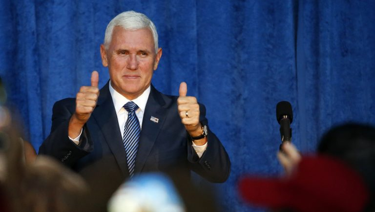 Republican vice presidential candidate Indiana Gov. Mike Pence arrives at a campaign rally