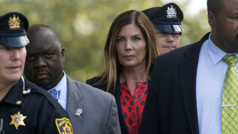 Pennsylvania Attorney General Kathleen Kane, center, leaves the Montgomery County courtroom where her trial for leaking grand jury testimony and then lying about it is underway, Wednesday. Aug. 10, 2016, in Norristown, Pa. (Clem Murray/Philadelphia Inquirer via AP, Pool)