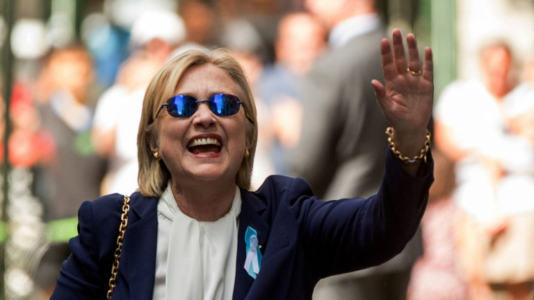 Democratic presidential candidate Hillary Clinton waves after leaving an apartment building Sunday in New York. Clinton's campaign said the Democratic presidential nominee left the 9/11 anniversary ceremony in New York early after feeling