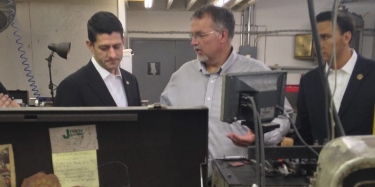 House Speaker Paul Ryan, U.S. Rep. Ryan Costello, R-Pennsylvania, right, and Scott Johnson, center, owner of J-Tech tour the company in Chester Springs in October. (AP Photo/Alan Fram)