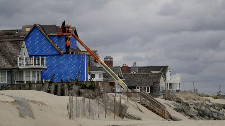 Construction workers labor on a beachfront home in Bay Head