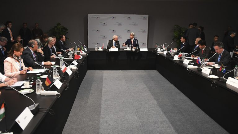 US Secretary of State John Kerry , background right, and former Moroccan ambassador to the US Aziz Mekouar chair a major economies forum meeting, at the COP22 climate change conference in Marrakech, Wednesday, Nov 16, 2016. (Mark Ralston, Pool Photo via AP)
