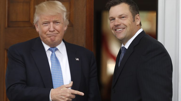 President-elect Donald Trump greets Kansas Secretary of State, Kris Kobach, as he arrive at the Trump National Golf Club Bedminster clubhouse, Sunday, Nov. 20, 2016, in Bedminster, N.J. (AP Photo/Carolyn Kaster)