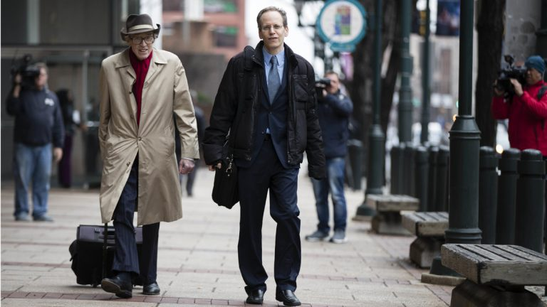 Ilann Maazel (center) and Gregory Harvey,  attorneys for the Green Party presidential candidate Jill Stein campaign, are hoping a Philadelphia judge will be the first to give them access to voting machines and software so they can look for signs of hacking in the presidential election. (AP Photo/Matt Rourke)