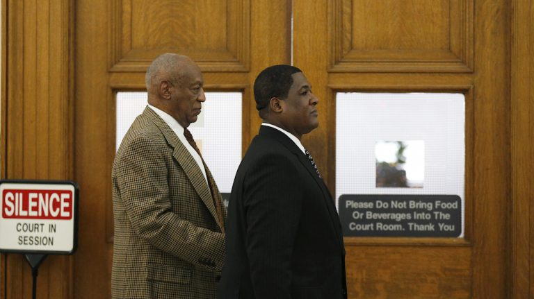Bill Cosby, left, leaves the courtroom during a break in the pretrial hearing in his sexual assault case at the Montgomery County Courthouse in Norristown, Pa., Tuesday. Lawyers for Cosby will battle in court to try to limit the number of other accusers who can testify at the comedian's sexual assault trial. (David Maialetti/The Philadelphia Inquirer via AP, Pool)