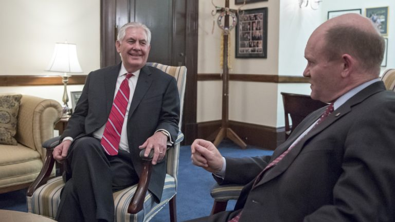 Secretary of State-designate Rex Tillerson (left) meets with Senate Foreign Relations Committee member Sen. Chris Coons, D-Delaware, Wednesday in Washington. The committee will conduct Tillerson's confirmation hearing. (AP Photo/J. Scott Applewhite