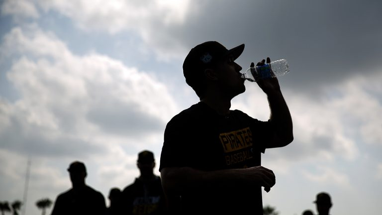 The city of Pittsburgh's water and sewer authority will be restructured in the near future. In this photo from Feb. 14, 2017, Adam Frazier of the Pittsburgh Pirates takes a drink after a spring training workout in Florida. (AP Photo/David Goldman)