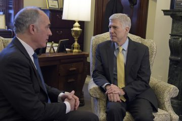 Sen. Bob Casey, Jr., D-Pa., left, talks with Supreme Court Justice nominee Neil Gorsuch at the beginning of their meeting on Capitol Hill in Washington, Thursday, Feb. 16, 2017. (AP Photo/Susan Walsh)