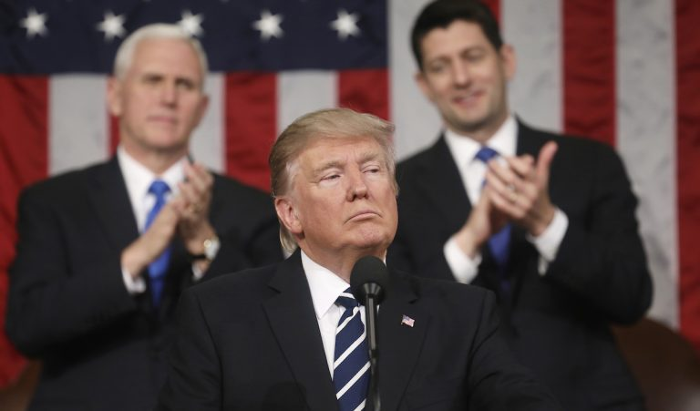 President Donald Trump addresses a joint session of Congress on Capitol Hill in Washington, Tuesday, Feb. 28, 2017, as Vice President Mike Pence and House Speaker Paul Ryan of Wis., listen. (Jim Lo Scalzo/Pool Image via AP)