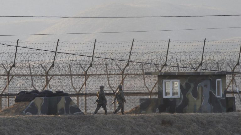 South Korean army soldiers patrol along the barbed-wire fence in Paju, South Korea, near the border with North Korea, Monday, March 6, 2017. North Korea on Monday fired four banned ballistic missiles that flew about 1,000 kilometers (620 miles), with three of them landing in Japan's exclusive economic zone, South Korean and Japanese officials said, in an apparent reaction to huge military drills by Washington and Seoul that Pyongyang insists are an invasion rehearsal. (AP Photo/Ahn Young-joon)