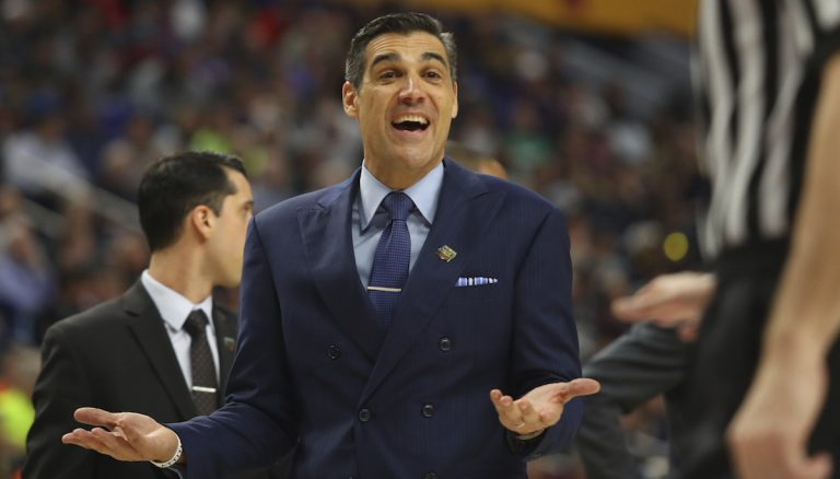 Villanova head coach Jay Wright speaks to an official during the first half of a second-round men's college basketball game against Wisconsin in the NCAA Tournament, Saturday, March 18, 2017, in Buffalo, N.Y. (AP Photo/Bill Wippert)