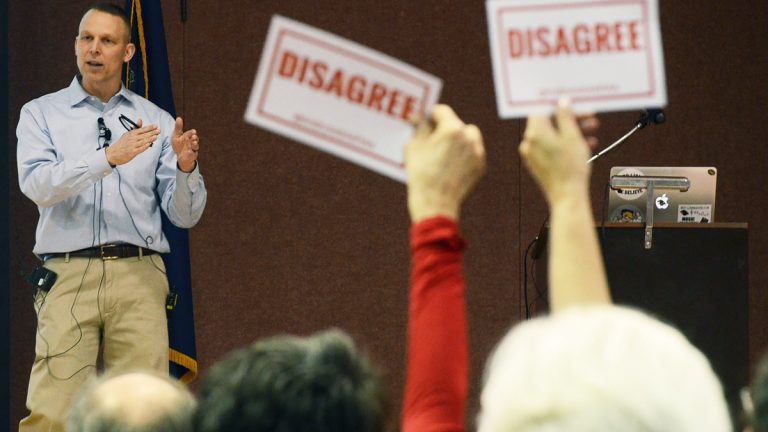 At a March 18 town hall, constituents disagree with a statement by Pennsylvania U.S. Rep. Scott Perry. A crowd unhappy with his support of the American Health Care Act showed up at his office a day after its approval.(AP Photo/Marc Levy)