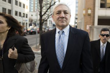 Graham Spanier walks to the Dauphin County Courthouse in Harrisburg, Pa., Monday, March 20, 2017. (Matt Rourke/AP Photo)