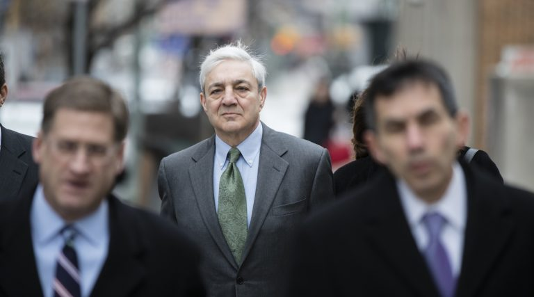 Former Penn State president Graham Spanier walks to the Dauphin County Courthouse in Harrisburg, Pa., Friday, March 24, 2017. (AP Photo/Matt Rourke)