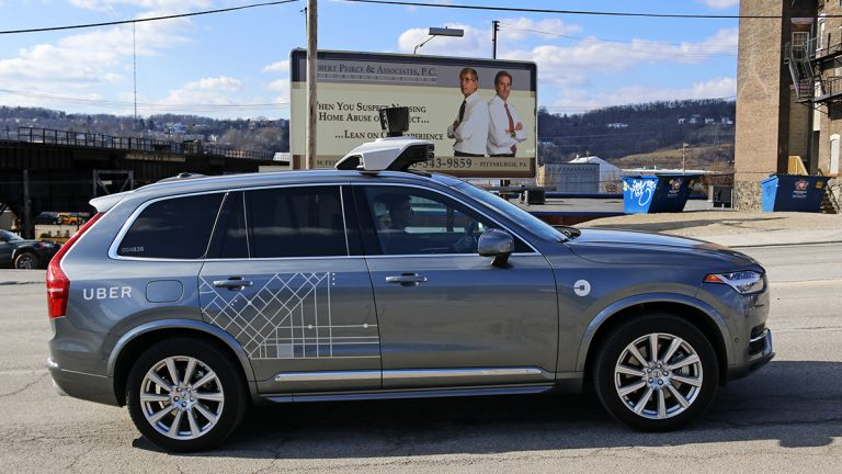 One of Uber's self-driving cars rolls through Pittsburgh on March 17, 2017. The company has agreed to pay the state $3.5 million to settle a long-running dispute about its license to operate. (AP Photo/Gene J. Puskar)
