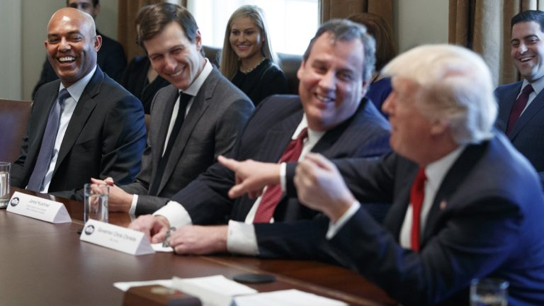 President Donald Trump jokes with former New York Yankees pitcher Mariano Rivera, left, during a listening session on opioid and drug abuse Wednesday in the Cabinet Room of the White House in Washington. From left are, Rivera, White House senior adviser Jared Kushner, New Jersey Gov. Chris Christie and Trump. (AP Photo/Evan Vucci)