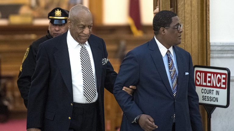 Bill Cosby is escorted from Montgomery County Courtroom A after after a pretrail hearing in his sexual assault trail ended April 3, 2017 in Norristown, PA. (CLEM MURRAY / Staff Photographer)