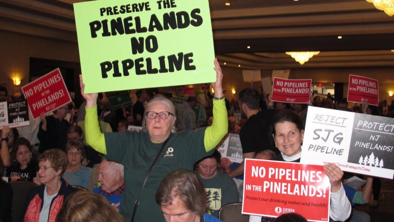 In this Feb. 24, 2017, photo, opponents of a natural gas pipeline planned to run through the ecologically sensitive Pinelands region of New Jersey protest at a meeting of the New Jersey Pinelands Commission at which the project was improved in Atlantic City, N.J. On Monday, April 10, 2017, the New Jersey Sierra Club appealed the decision, claiming the commission did not follow its own rules in approving the project. (AP Photo/Wayne Parry)