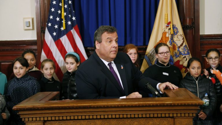 Surrounded by a group of visiting school children from Lakewood, N.J., New Jersey Gov. Chris Christie speaks at a news conference in his offices in Trenton, N.J., Monday, May 22, 2017. Christie is touting the state's 4.1 percent unemployment rate as he urged voters in this year's race for governor not to vote for candidates who will reverse his policies. (AP Photo/Seth Wenig)