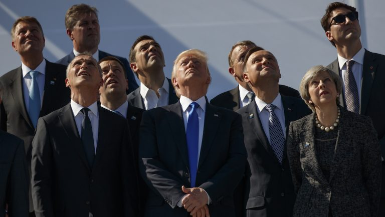 President Donald Trump and NATO leaders watch a flyover during a transfer ceremony at the new NATO headquarters, Thursday, May 25, 2017, in Brussels. (AP Photo/Evan Vucci)