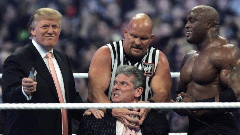 In this Sunday, April 1, 2007, file photo, WWE Chairman Vince McMahon, center, held by