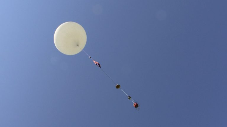 An 8-foot camera-carrying balloon has a test launch before Monday's solar eclipse. (AP Photo/Pat Eaton-Robb)