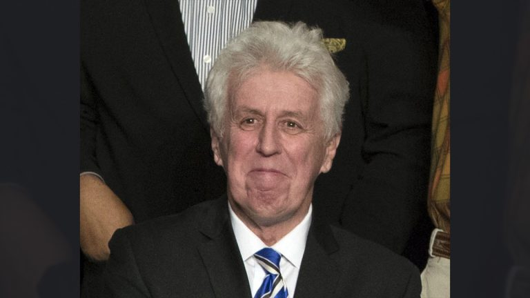 In this Dec. 15, 2016, photo, CNN commentator Jeffrey Lord, appears at a rally for President-elect Donald Trump in Hershey, Pa. CNN cut ties Thursday, Aug. 10, 2017, with Lord, a conservative commentator, after he tweeted a Nazi salute at a critic. (AP Photo/Matt Rourke, File)