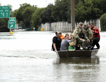 Residents are rescued from their homes surrounded by floodwaters from Tropical Storm Harvey on Sunday, Aug. 27, 2017, in Houston, Texas. (AP Photo/David J. Phillip)