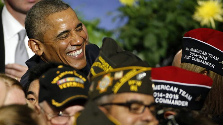 President Barack Obama shares a laugh with a veteran following his address at the Veterans of Foreign Wars National Convention at the David Lawrence Convention Center in Pittsburgh, Tuesday. (AP Photo/Gene J. Puskar)