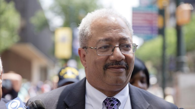 U.S. Rep. Chaka Fattah leaves federal court after his conviction  Tuesday on racketeering and conspiracy charges. (Matt Rourke/AP Photo)