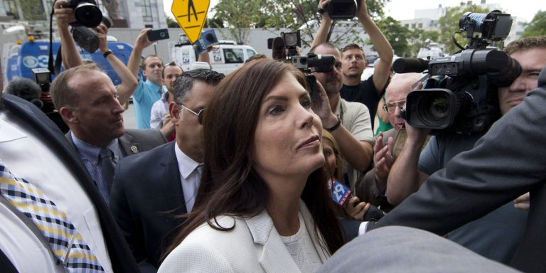 Pennsylvania Attorney General Kathleen Kane arrives to be processed and arraigned on charges she leaked secret grand jury material and then lied about it under oath on Saturday at the Montgomery County detective bureau in Norristown.