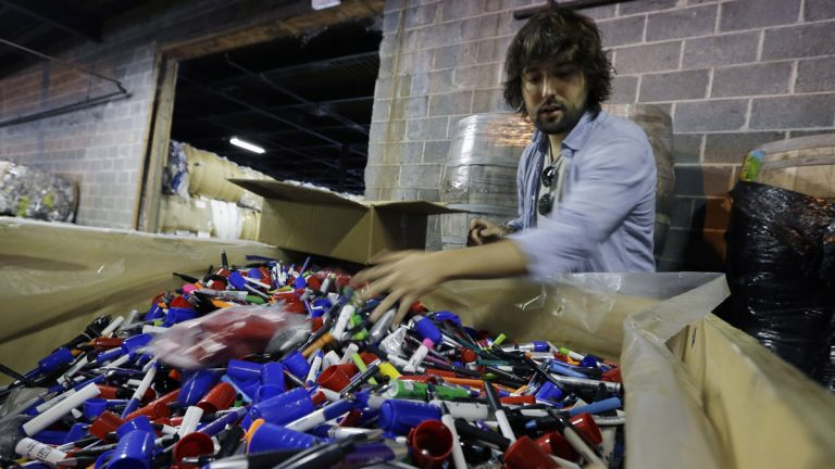 TerraCycle Inc. founder Tom Szaky sorts through a large box of marker pens in the company's Trenton