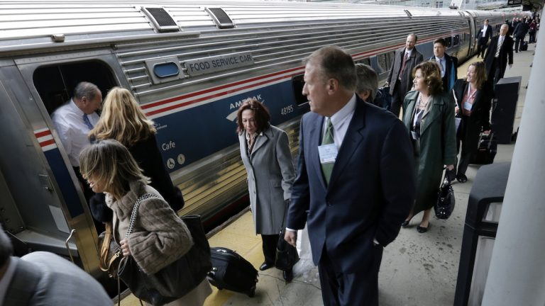 People head to assigned cars to board the annual New Jersey Chamber of Commerce's 'Walk to Washington' train at the Trenton train station Thursday, Feb. 25, 2016, in Trenton, N.J. The Amtrak train gets its name from the idea that state lawmakers, lobbyists and business leaders walk up and down the train isles, networking, all the way from Newark to the nation's capital in a train chartered by the New Jersey Chamber of Commerce. (AP Photo/Mel Evans)