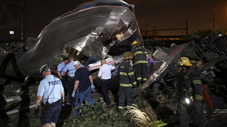 Emergency personnel work the scene of a train wreck May 12 in Philadelphia after an Amtrak train headed to New York City derailed and crashed. (AP Photo/Joseph Kaczmarek)