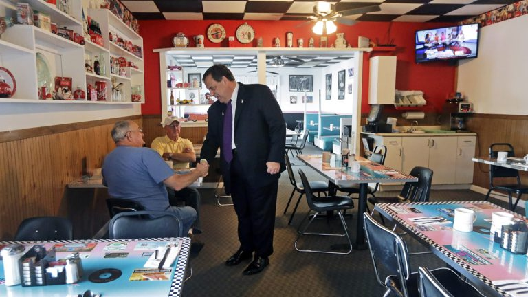 Republican presidential candidate New Jersey Gov. Chris Christie shakes hands with a potential voter at the Pink Cadillac Diner before a campaign town hall meeting last week  in Rochester, New Hampshire. (AP Photo/Elise Amendola)