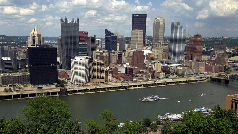 The Monongahela River lies to the south of Pittsburgh's central business district. Before efforts to improve the city's air and water, the skyline's edges used to be blurred by pollution. (AP Photo/Bill Sikes)