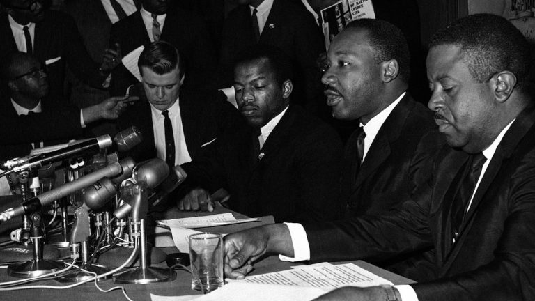 FILE - In this April 2, 1965 file photo, Dr. Martin Luther King Jr., second from right, speaks at a news conference next to John Lewis, to his left, chairman of the Student Nonviolent Coordinating Committee, in Baltimore. (AP Photo/William A. Smith, File)