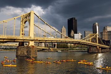 Kayakers paddle past downtown Pittsburgh on the Allegheny River in this September 4, 2015 photo. (AP File Photo/Gene J. Puskar)