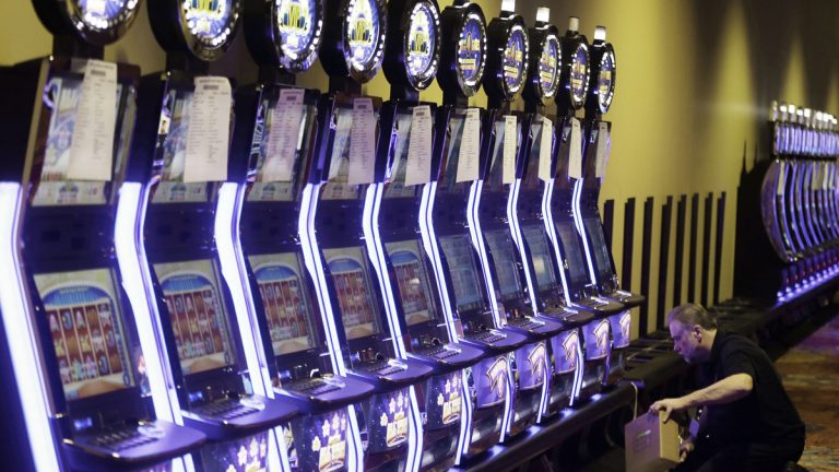 A worker checks an array of video gambling terminals  at Thistledown Racino in North Randall, Ohio. Pennsylvania lawmakers are considering legalizing the video gambling terminals in bars and other businesses.(AP file photo)