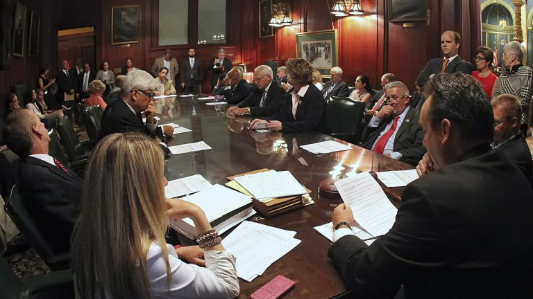 Pennsylvania senators gather to discuss pension legislation in the Rules Committee ahead of floor debate at the state Capitol in Harrisburg last week. Democratic Gov. Tom Wolf rejected the GOP's overhaul plan Thursday. (AP Photo/Chris Knight)