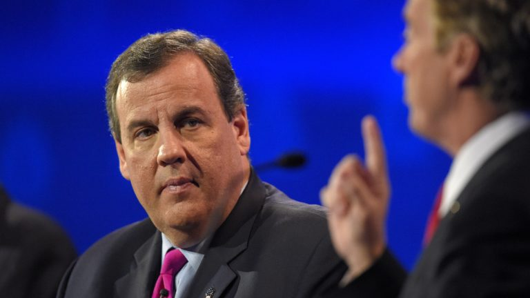 New Jersey Gov. Chris Christie listens to Sen. Rand Paul make a point during last month's GOP presidential debate in Colorado. For Tuesday's debate, Christie has been demoted to the preliminary event, sharing a stage with former Louisiana Gov. Bobby Jindal, former Arkansas Gov. Mike Huckabee and former U.S. Sen. Rick Santorum of Pennsylvania. (AP photo/Mark J. Terrill)