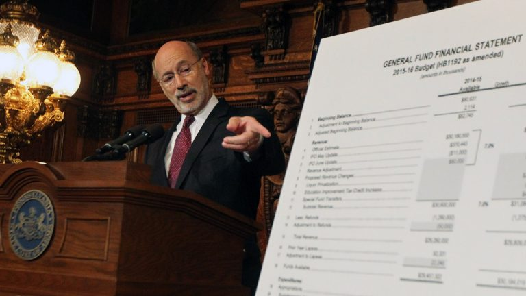 Pennsylvania Gov. Tom Wolf points out details of a budget plan last week at the state Capitol in Harrisburg. Wolf and the Republican-controlled Legislature remain deadlocked on a state spending plan a week after the budget was due.  (AP photo/Chris Knight)