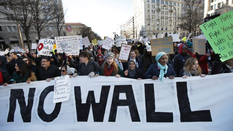 Demonstrators march along Pennsylvania Avenue past the Trump International Hotel in Washington Saturday to protest the immigration policies of President Donald Trump. New Jersey Senate Monday passed two measures Monday objecting to the president's plans to ban immigrants from seven Muslim-majority countries and build a wall between the U.S. and Mexico. (AP Photo/Manuel Balce Ceneta)