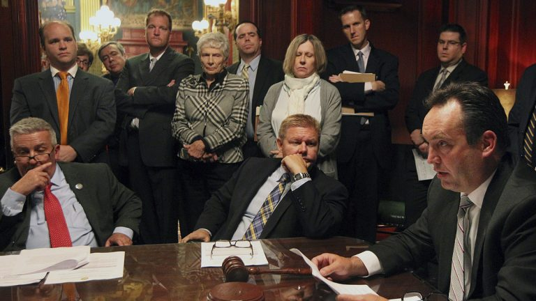 Pennsylvania Senate Majority Leader Jake Corman, R-Centre, right, flanked by his Republican colleagues, goes over pension legislation last week. Gov. Tom Wolf has until Friday night to act on that bill before it becomes law.(AP Photo/Chris Knight)