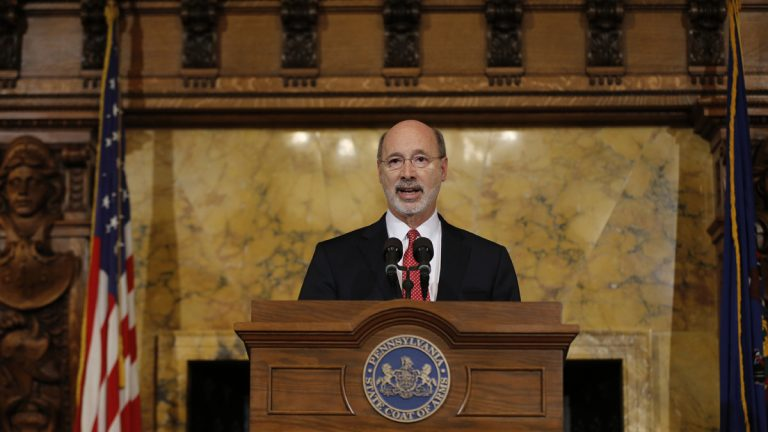 Pennsylvania Gov. Tom Wolf speaks with members of the media Tuesday at the state Capitol in Harrisburg. Wolf says he is rejecting parts of a $30.3 billion state budget plan that's already a record six months overdue, but he's freeing up more than $23 billion in emergency funding. (AP Photo/Matt Rourke)